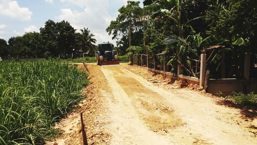 construction work Contructionwork Road Site Construction Tree Working Rural Scene Agriculture Field Sky Tractor Vehicle Roadways Street Scene Empty Road Agricultural Equipment Agricultural Machinery Irrigation Equipment