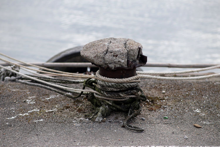Close-up of rope tied on sand