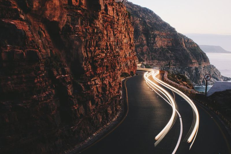 Without a doubt, Chapman's Peak drive is one of the most beautiful roads in the world. As the sun goes down, it also ends up being a brilliant spot to watch some light trails. Photography In Motion Landscapes With WhiteWall Road The KIOMI Collection Human Meets Technology Landscapes With Whitewall Winners The Great Outdoors With Adobe The Great Outdoors - 2016 EyeEm Awards Market Reviewers' Top Picks 43 Golden Moments Overnight Success