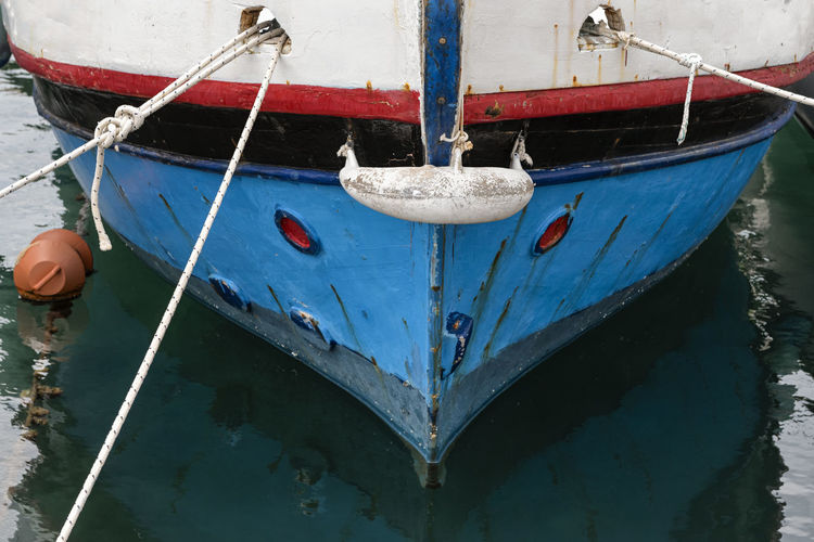 Fishing Boat Nautical Vessel Mode Of Transportation Water Moored Transportation Rope Blue Buoy Sea Reflection Tied Up Fishing Boat Anchored Harbor White Background Mooring Rope Mooring Line Old Weathered Beautiful Outdoors Travel Reflection Reflections