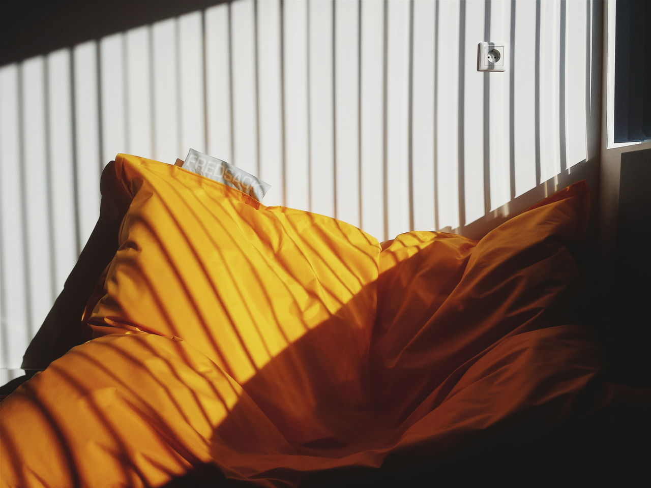 clothing, textile, indoors, window, fabric, no people, home interior, bed, curtain, yellow, day, pillow, hanging, sheet, bedroom, close-up, coathanger