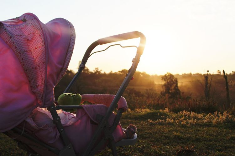 Baby In Carriage Against Sky