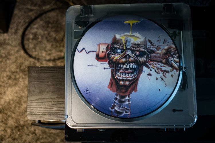 Close-up Focus On Foreground No People Day Technology Animal Representation Indoors  Machinery Circle Number Wood - Material Glass - Material Geometric Shape Transparent Record Record Player Iron Maiden