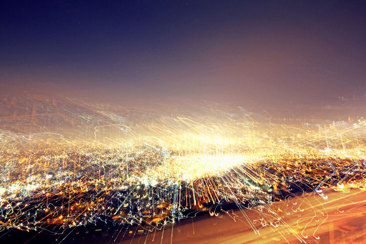 Aerial View Blurred Motion City Cityscape Clear Sky Crowded Glowing High Angle View Illuminated Landscape Light Light - Natural Phenomenon Light Trail Long Exposure Motion Night No People Outdoors Road Sky