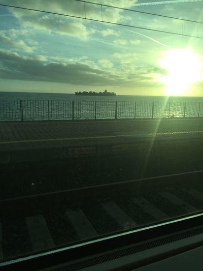 Scenic view of sunset seen through window
