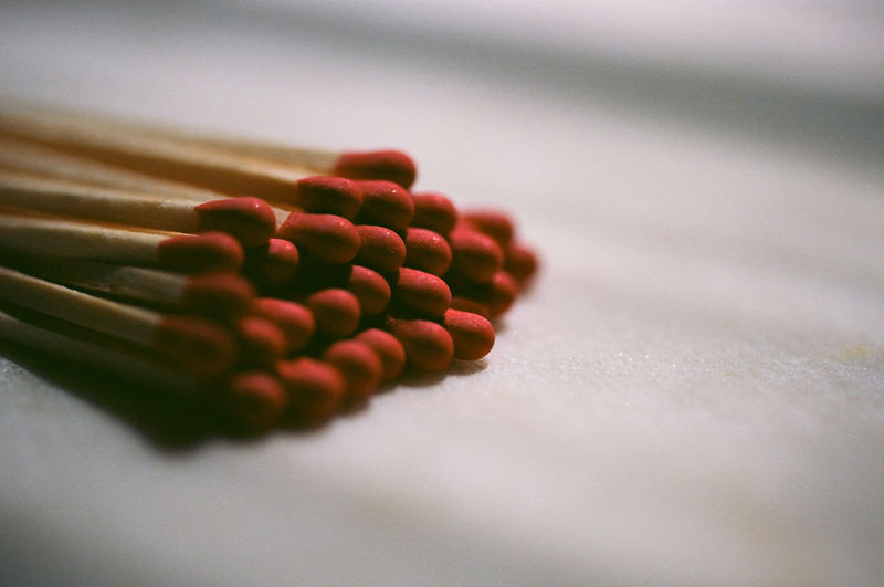 Close-up of matchsticks on table at home