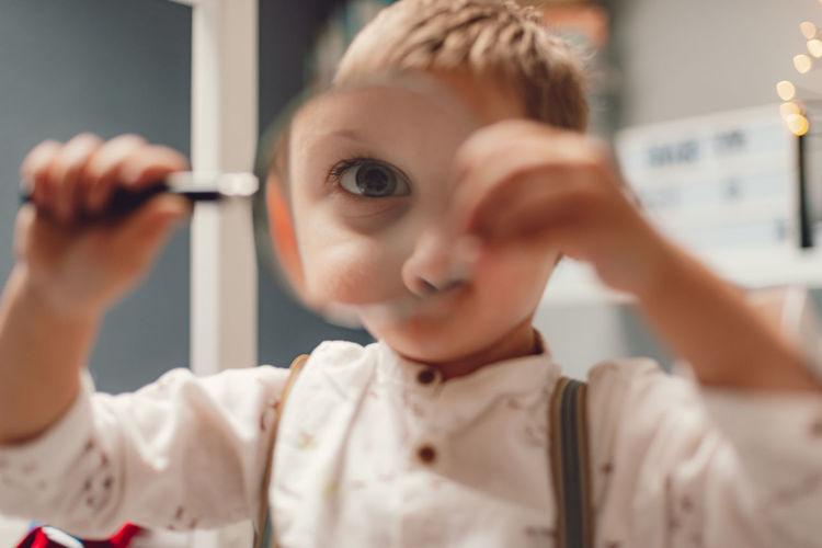 Little boy searching for fun
