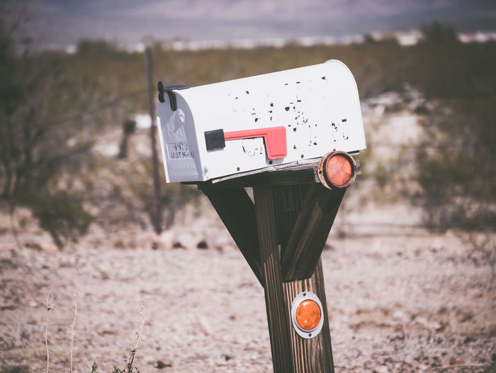 Close-up of mailbox on land