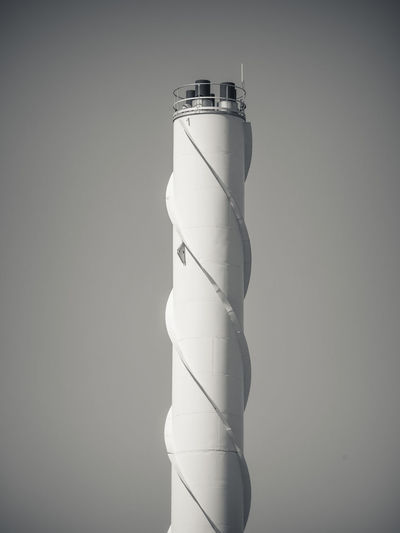 Low angle view of chimney against clear sky