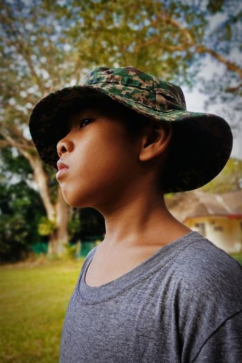 Portrait of a young boy looking away