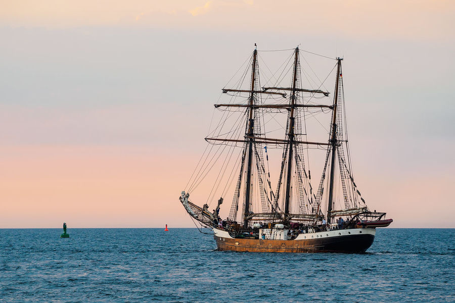 Sailing ships on the Baltic Sea in Warnemuende, Germany. Baltic Sea Hanse Sail Relaxing Rostock Sailing Ship Tall Ship Warnemünde Coast Day Evening Journey Nature No People Ocean Outdoors Sea Shore Sky Sunset Tourism Travel Destinations Vacation Warnemuende Water Windjammer