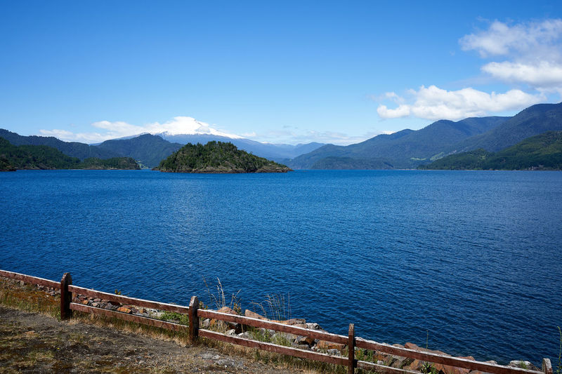 Panguipulli lake... Water Beauty In Nature Sky Scenics - Nature Mountain Tranquil Scene Tranquility Cloud - Sky Day Nature Mountain Range Non-urban Scene Blue Idyllic Railing No People Sea Outdoors Barrier Lake Scenics Landscape Tourism Aroundtheworld Travel Destinations