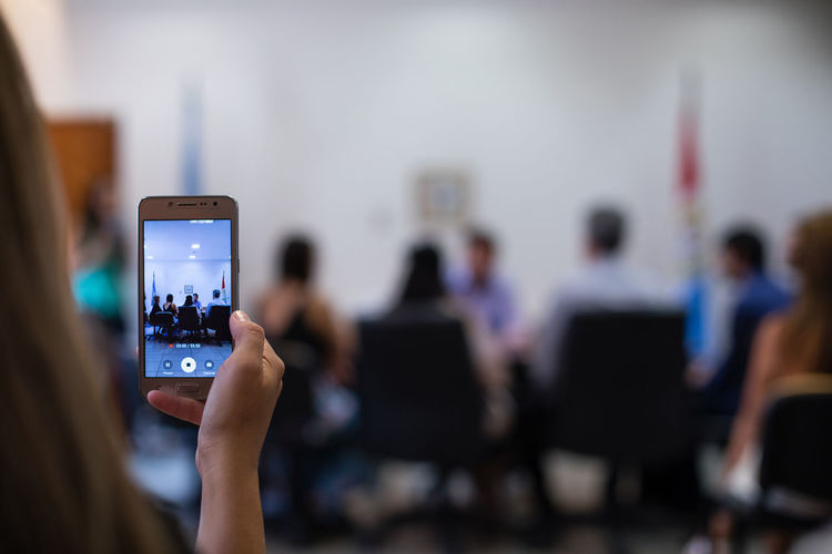 Rec Activity Adult Communication Connection Crowd Filming Focus On Foreground Group Group Of People Home Video Camera Indoors  Mobile Phone People Phone Photographing Photography Themes Portable Information Device Real People Recording Screen Smart Phone Technology Wireless Technology Women