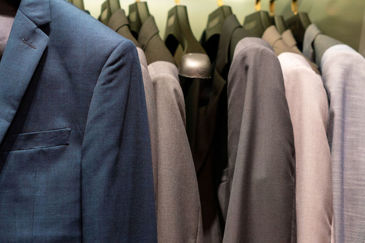 Coat hanging on rack in store for sale
