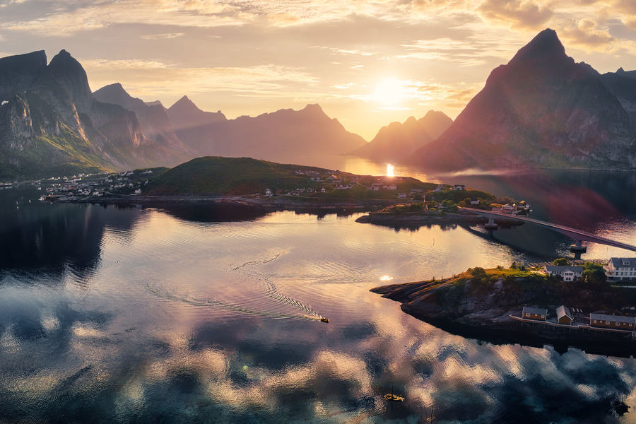 Landscape of Reine in Lofoten, Norway Norway Reine Beauty In Nature Cloud - Sky Hamnøy Idyllic Lofoten Mountain Mountain Range Nature Nautical Vessel No People Orange Color Outdoors Reflection Scenics - Nature Sky Sunlight Sunset Tranquil Scene Tranquility Transportation Travel Water