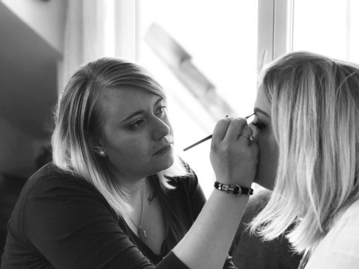 Artist Applying Make-Up On Woman Face