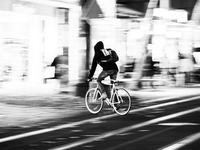Bicycle in motion Bicycle Blackandwhite Blurred Motion City Healthy Lifestyle Long Exposure Men Mode Of Transport Motion One Person Road Speed Sport Transportation