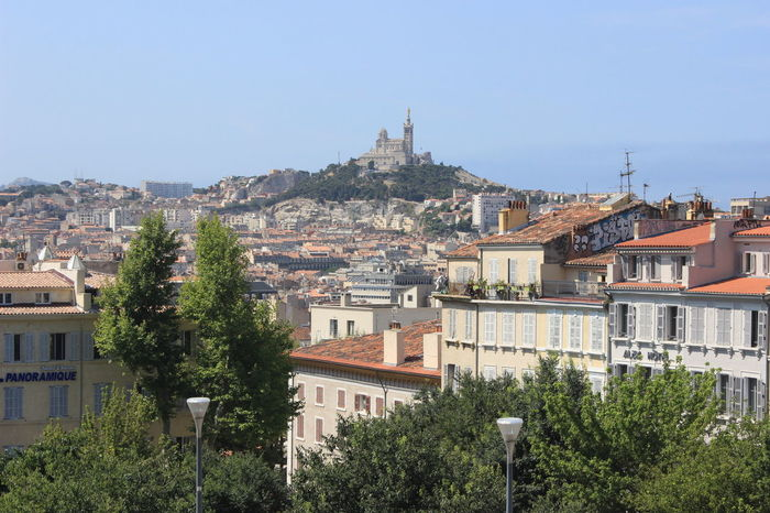 Architecture Blue Building Exterior City Cityscape Cultures Day House Landscape Marseilles Medieval Outdoors Place Of Worship Residential Building Roof Sky Town Travel Destinations Tree Urban Skyline