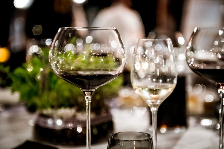 Close-up of wineglasses on table at restaurant