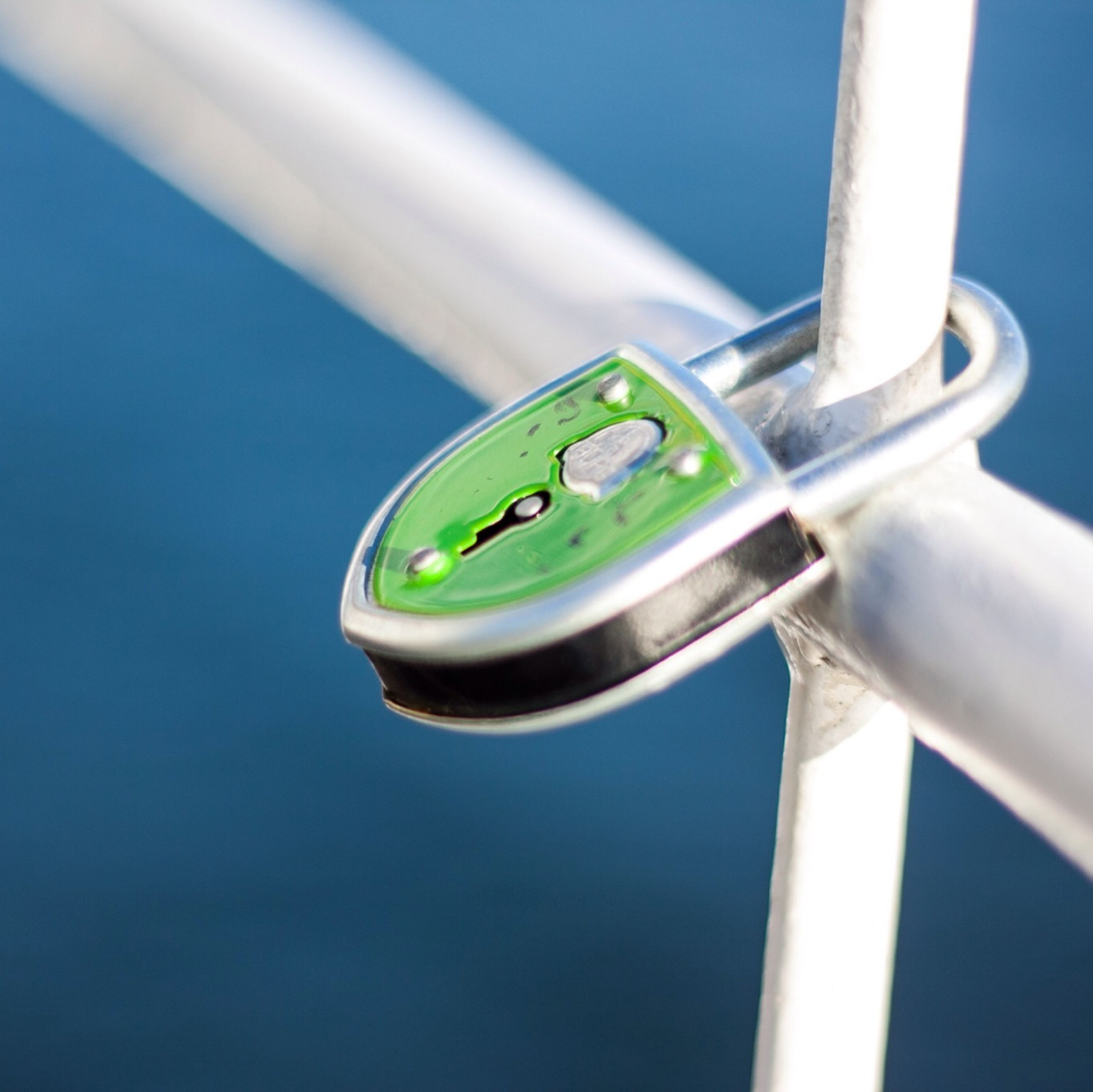 blue, low angle view, clear sky, metal, close-up, green color, day, no people, sunlight, part of, outdoors, transportation, metallic, copy space, sky, pole, built structure, nature, reflection, water