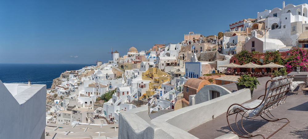 View of Oia - Santorini Cyclades Island - Aegean sea - Greece Building Exterior Architecture Built Structure Sky Building City Residential District Nature Clear Sky No People Water Sunlight Travel Destinations Travel House Town Blue Sea Outdoors Cityscape TOWNSCAPE Greece Santorini Oia Cyclades