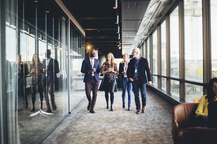 Group of people walking in corridor