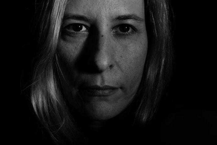 out of the dark ~> © 2018 Carla de Sousa Black Background Portrait