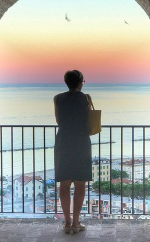 Sunrise Sea Water Sky One Person Railing Horizon Over Water Rear View Horizon Scenics - Nature Sunset Looking At View