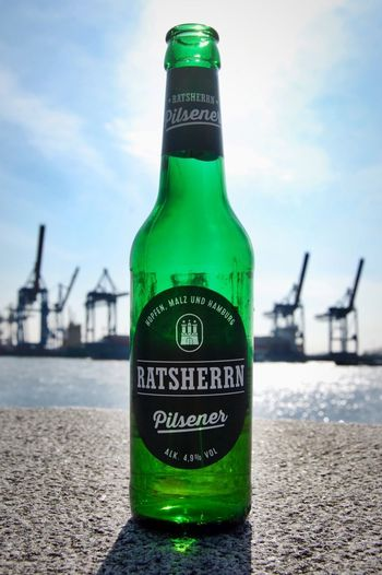 break. Easter 2018 My Point Of View Friday Elbe Water Harbour Harbor Detail Break Hamburgmeineperle Hamburg Bottle Container Text Western Script Water Communication Nature Beer Bottle Drink Sky Alcohol Refreshment Green Color Food And Drink Beer - Alcohol Focus On Foreground No People Glass - Material Beer