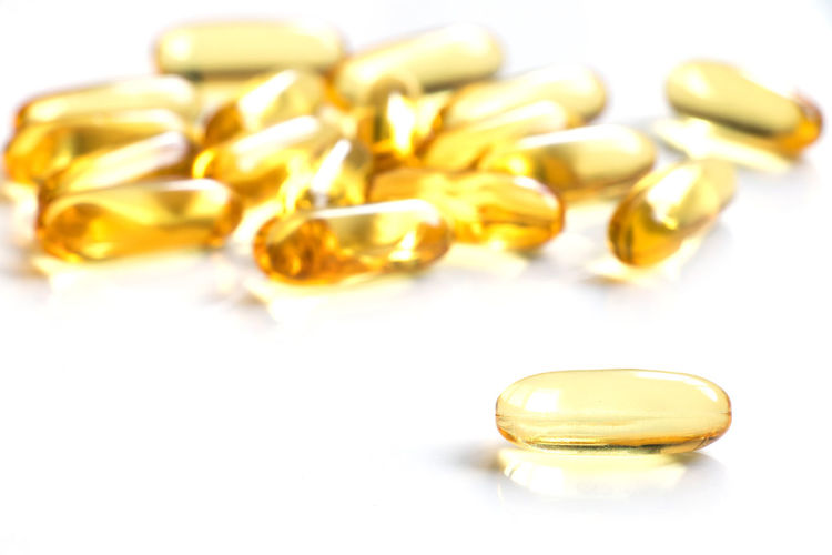 Yellow soft gelatin capsule on white background Care Copy Space Doctor  Pharmacist Alternative Medicine Banner Capsule Capsules Close-up Healthcare And Medicine Healthy Healthy Lifestyle Herbal Medicine Medicine Nutritional Supplement Patient Pharmaceutical Pill Prescription Medicine Soft Gelatin Capsule Vitamin White Backround