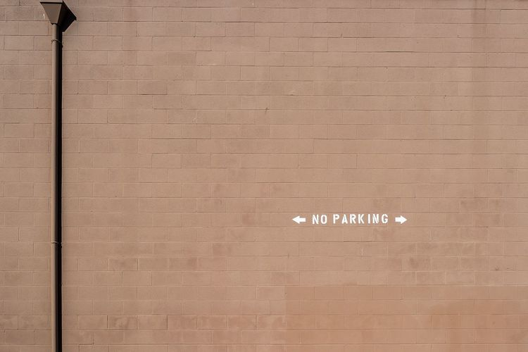 no parking Pattern Clean Wallpaper Wall Bricks Pipe Minimal Minimalism Noparking Parking Communication Text Pattern Full Frame Backgrounds Textured  No People Brown Arrow Symbol Wall - Building Feature Message Sign Built Structure Symbol Day