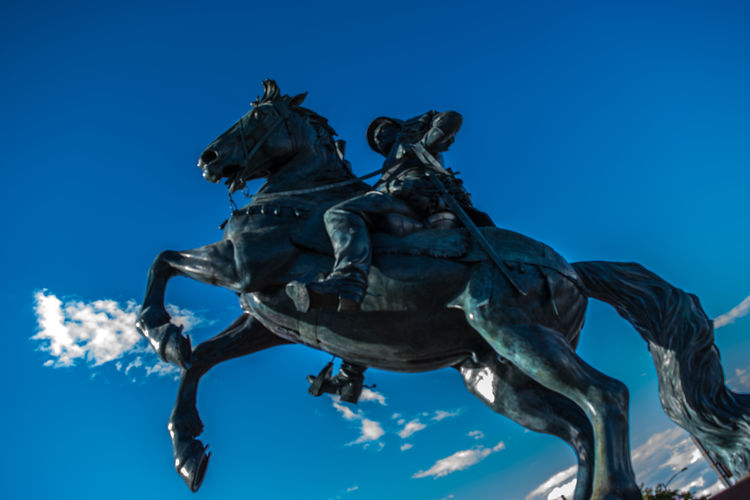 Art Art And Craft Blue Clear Sky Day History Horse Horseback Riding Human Representation Low Angle View Memorial Monument Outdoors Sculpture Sky Statue