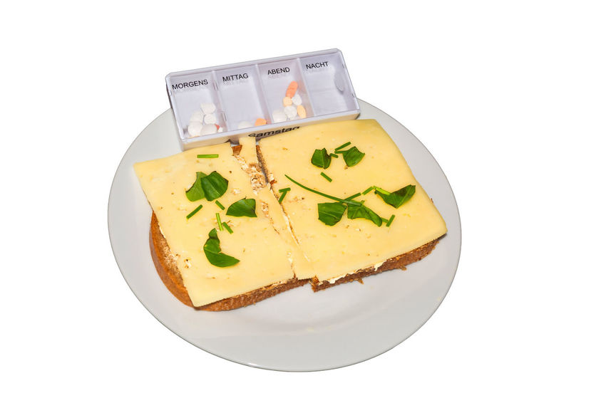 Simple cheese bread with fresh herbs and a medicine box on a white plate against neutral background. Pills Bread Cheese Cheese Bread Close-up Daily Dose Day Food Food And Drink Freshness Healthcare And Medicine Indoors  No People Ready-to-eat Studio Shot Tablets Unhealthy Eating White Background