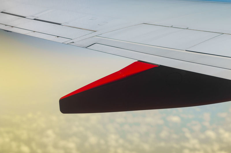 Wing side flight Aerial Air Air Vehicle Aircraft Aircraft Wing Airline Airplane Airplane Window Airplaneview Aviation Close Up Clouds Engine Flight Flying Left Wing Passenger Plane Sky Sunset TakeOff Travel View Warm Wing