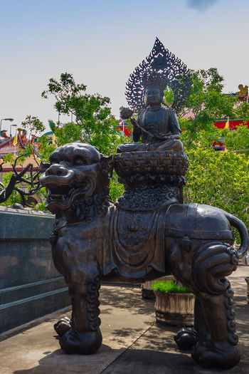 Beautiful Chinese's style sculptures at Anek Kusala Sala (Viharn Sien), Thai-Chinese temple in Pattaya, Thailand. It was built in 1987 and is one of popular tourist attractions Anek Kusala Chinese Doll Sculpture Park Viharnra Sien Art And Craft Chinese Culture Chinese Temple Creativity Day Human Representation Immortal Male Likeness No People Outdoors Place Of Worship Religion Sculpture Sculpture Garden Sky Spirituality Statue Tree