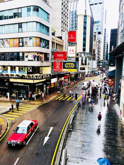 Hong Kong city life Urban Exploration Streetphotography Taxi Transportation City Mode Of Transportation Car Street Motor Vehicle Building Exterior Architecture Land Vehicle Built Structure Road Wet Group Of People Large Group Of People Travel City Street Day City Life #urbanana: The Urban Playground
