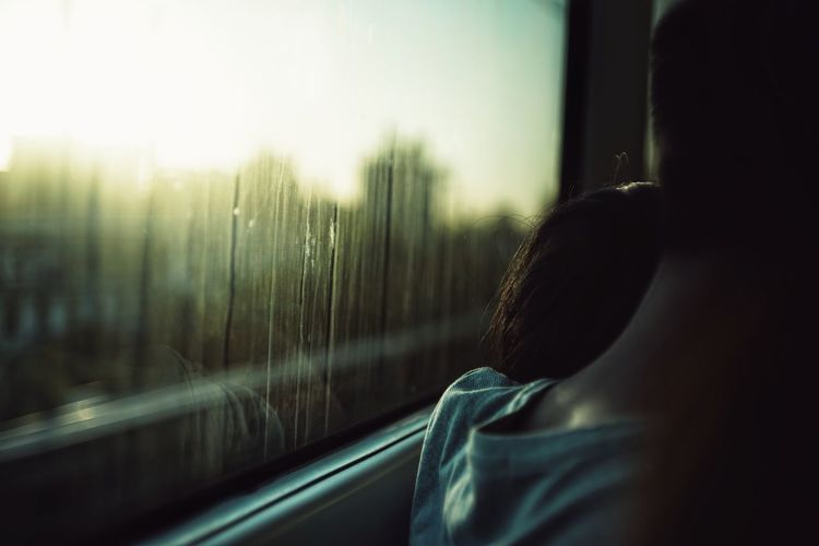 Cropped image of couple in train