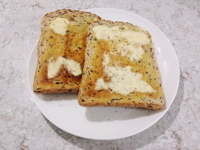 Breakfast, two slices of toast Toast🍞 Plate Breakfast Food And Drink No People Healthy Eating Toasted Bread Freshness Close-up Bread Food Ready-to-eat Food Stories