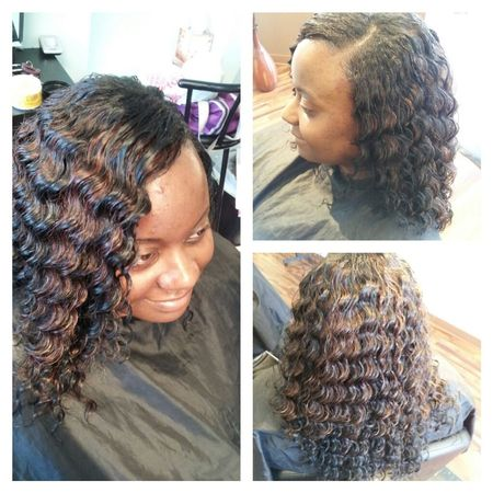 FULL SEW-IN WITH DEEP WAVY HAIR.