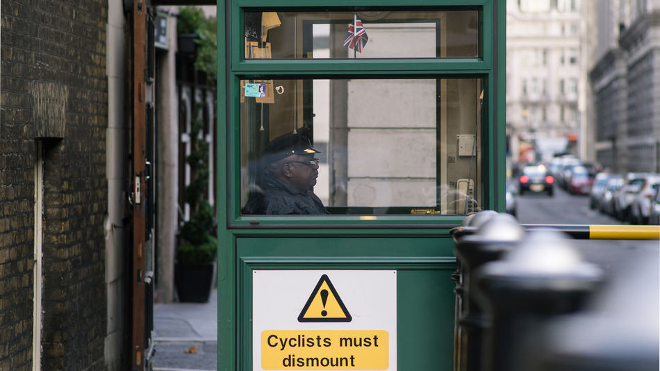 Cyclers must dismount! Cabin Cabinet Check This Out City City Of London Communication Day Gate Gatekeeper Gates London LONDON❤ Man Outdoors Turkishfollowers Waiting waiting game Warden Watcher Watchman The Street Photographer - 2017 EyeEm Awards The Photojournalist - 2017 EyeEm Awards EyeEm LOST IN London