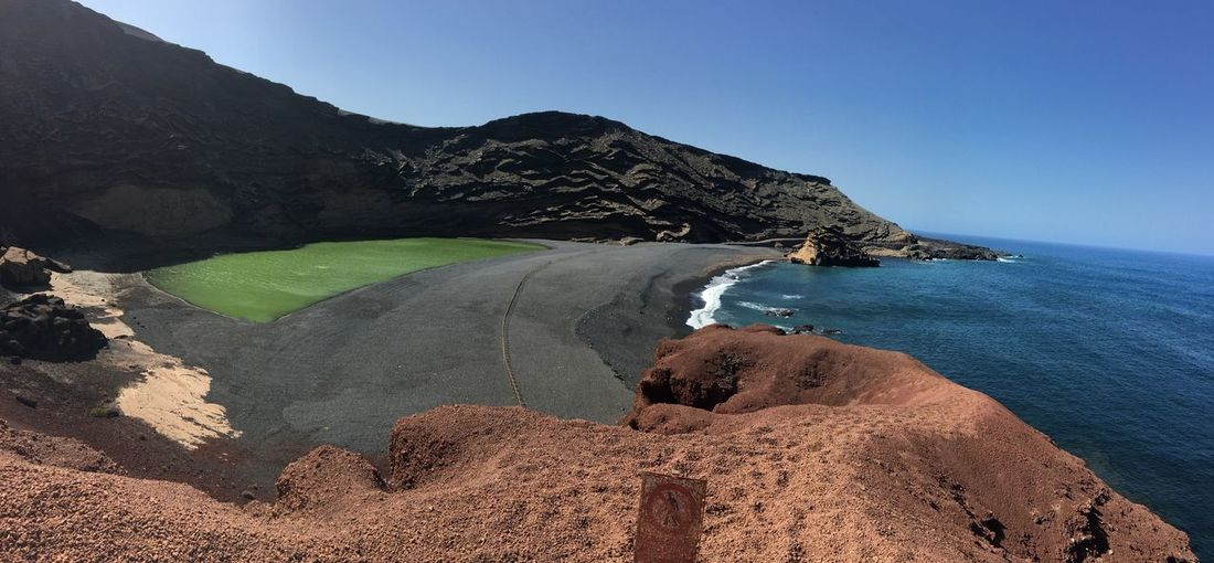 Lago verde Canarias Lago Verde Lanzarote Water Beauty In Nature Sky Scenics - Nature Land Tranquil Scene Mountain Non-urban Scene Beach Nature Tranquility No People Sand Clear Sky
