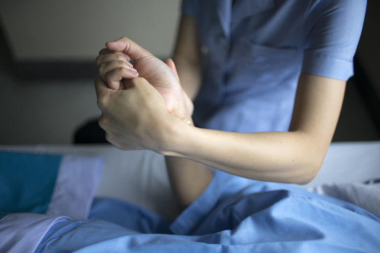 High angle view of nurse examining patient