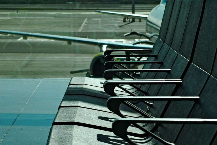 waiting at the Airport Bench Plane Reflection Sunlight Transportation Waiting Airplane Airport Close-up Day Glass Indoors  No People Sun Window Colour Your Horizn