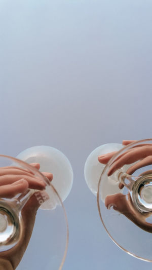 Cropped hand of woman holding wineglasses