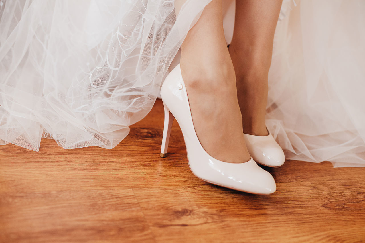 wedding, event, newlywed, women, bride, low section, wedding dress, human body part, adult, life events, celebration, shoe, human leg, indoors, hardwood floor, body part, real people, people, wood, love, flooring, human foot, human limb