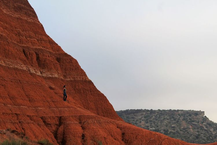 Woman Hiking On Mountains At Grand Canyon National Park