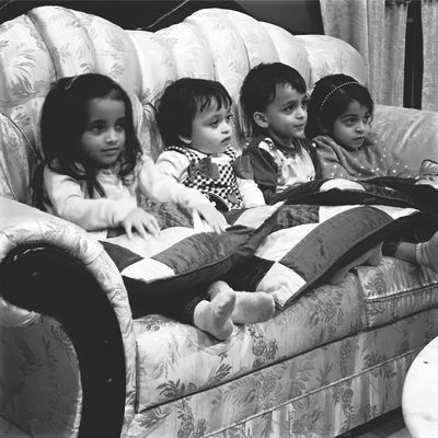 Child Girls Boys Childhood Elementary Age Full Length Sitting Lifestyles Happiness Togetherness Children Only Real People People Smiling Cheerful Portrait Day Indoors  Adult Black And White Photography Photo
