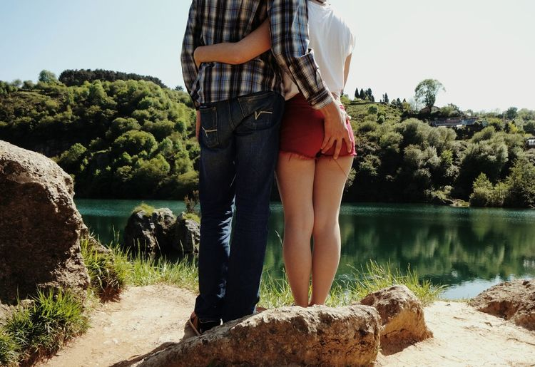 Rear view of a couple against the lake