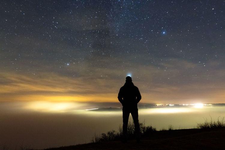 Full length of man against sky at night