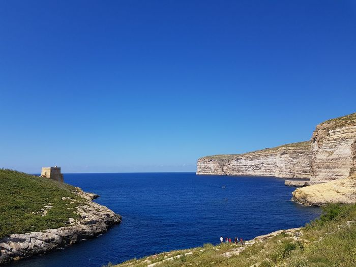 seascape People Tourism Tourist Attraction  Tourquise Sea No Filter No Edit Mediterranean  Malta Gozo Island Malta Water Sea Clear Sky Beach Blue Rock - Object Sky Horizon Over Water Rocky Coastline Seascape Coast Coastline Seashore Calm